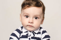 Portrait of a cute baby boy looking at camera with his big eyes. Stock Photos