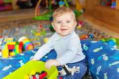 Portrait of cute baby boy of 6 months at home. Royalty Free Stock Photo