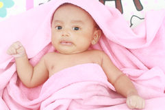 Portrait of cute baby boy with pink towel Stock Photography