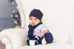 Portrait of a cute baby boy sitting and smiling. Adorable four month old child. Royalty Free Stock Images