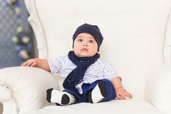 Portrait of a cute baby boy sitting and smiling. Adorable four month old child. Royalty Free Stock Photography