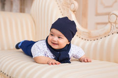 Portrait of a cute baby boy smiling. Adorable four month old child. Royalty Free Stock Photo