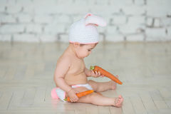 Portrait of a cute baby dressed in bunny ears Royalty Free Stock Image