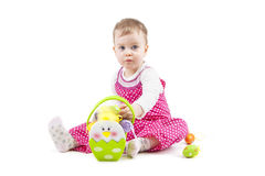 Portrait of a cute baby with Easter eggs. Cute baby dressed in Easter flower with eggs Stock Images
