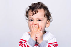 Portrait of a cute baby eating orange. Stock Photography