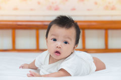 Portrait of cute baby girl on the bed Royalty Free Stock Photography
