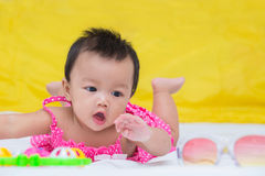 Portrait of cute baby girl on the bed with toy Royalty Free Stock Photos
