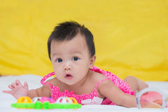 Portrait of cute baby girl on the bed with toy Royalty Free Stock Photo