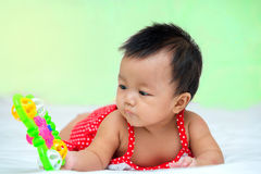 Portrait of cute baby girl on the bed with toy Royalty Free Stock Images