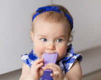 Portrait of cute baby girl with comb Stock Photography