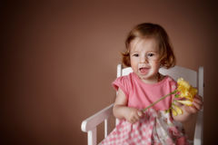 Portrait of a cute baby girl with flower Royalty Free Stock Images