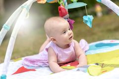 Portrait of cute baby girl, outdoors, light effect royalty free stock photo