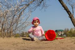 Portrait of a cute baby girl with a yellow flower in her hand royalty free stock photography