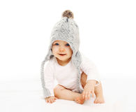 Portrait cute baby in grey knitted hat on white Stock Photo