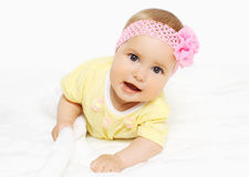 Portrait of cute baby in headband with flower Stock Image