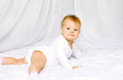 Portrait cute baby lying on the bed home Royalty Free Stock Images