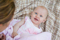 Portrait of a cute baby lying on blanket Royalty Free Stock Images