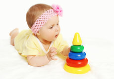 Portrait of cute baby lying and playing Royalty Free Stock Photo