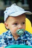Portrait of a cute baby with pacifier Stock Images