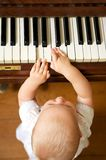 Portrait of a cute baby playing piano Stock Photo