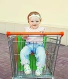 Portrait cute baby sitting in trolley Stock Photo