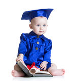 Portrait of cute baby in student hat with book Stock Images