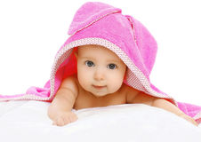 Portrait of cute baby under the pink towel Royalty Free Stock Photo