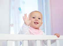 Portrait of a cute baby waving hello with hand Royalty Free Stock Image