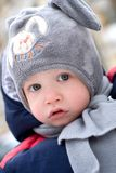 Portrait of a cute baby wearing a winter hat Stock Image