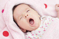 A portrait of a cute baby yawning Royalty Free Stock Photography