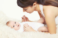 Portrait of cute baby with young mom at home Royalty Free Stock Photos