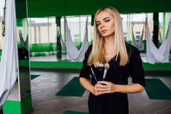 Portrait of a cute beautiful girl mekeup artist natural with long hair blond. In the studio, anti gravity fitness yoga . Stock Photo