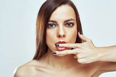 Portrait of cute beautiful young girl with finger in her mouth Stock Photo