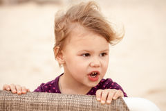 Portrait of cute blond baby girl with wind in her hair Royalty Free Stock Photo