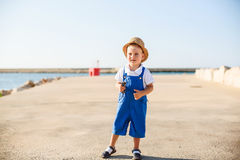 Portrait of a cute blond boy in hat Stock Photos