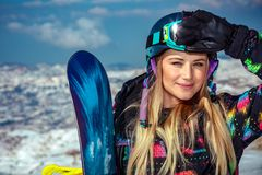 Snowboard trainer. Portrait of a cute blond snowboard trainer in the snowy mountains, extreme winter sport, competition between snowboarders, active wintertime stock photos