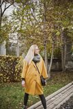 Portrait of cute blonde in autumn park royalty free stock photo