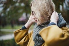 Portrait of cute blonde in autumn park stock photo