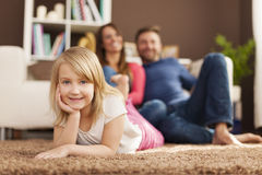 Portrait of cute blonde girl with parents Stock Images