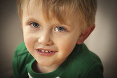 Portrait of Cute Blue Eyed Boy Stock Photo