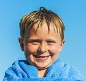 Portrait of cute boy at the beach Stock Photos