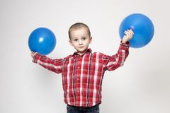 Portrait of cute boy with blue balloons Royalty Free Stock Images