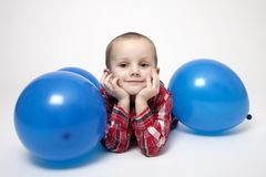 Portrait of cute boy with blue balloons Royalty Free Stock Image