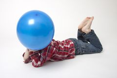 Portrait of cute boy with blue balloons Royalty Free Stock Photography