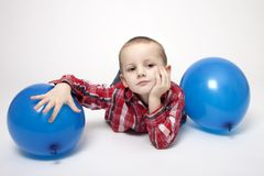 Portrait of cute boy with blue balloons Stock Photo
