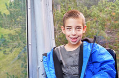Portrait of a cute boy in a cable car Royalty Free Stock Photo