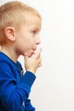 Portrait of cute boy child kid preschooler licking his fingers Stock Photo