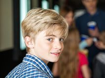 Portrait Of Cute Boy At Cinema Royalty Free Stock Image