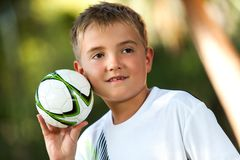 Boy holding small handball. Portrait of cute boy holding small handball outdoors Royalty Free Stock Photography