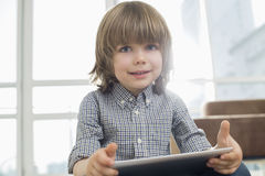 Portrait of cute boy holding tablet computer at home Royalty Free Stock Photo